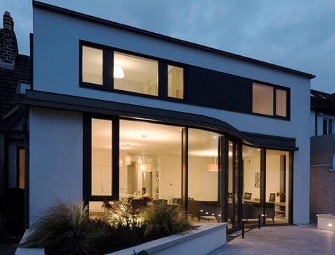 Residential Rebuild in Dublin - Glazed screen at night